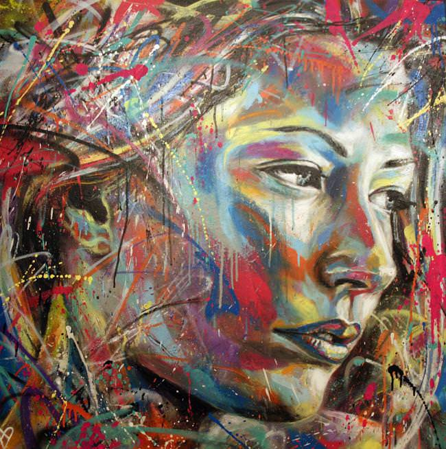 A beautiful woman comes to life in colorful spray paint in this graffiti painting by street artist David Walker