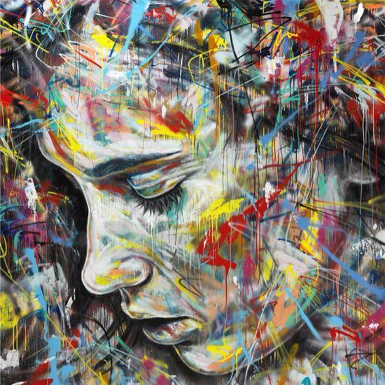 A colorful and messy graffiti portrait of a beautiful girl by street artist David Walker