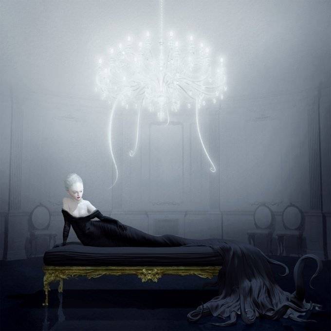 A pale woman with tentacles lies ona couch beneath a glowing chandelier in this painting by Ray Caesar