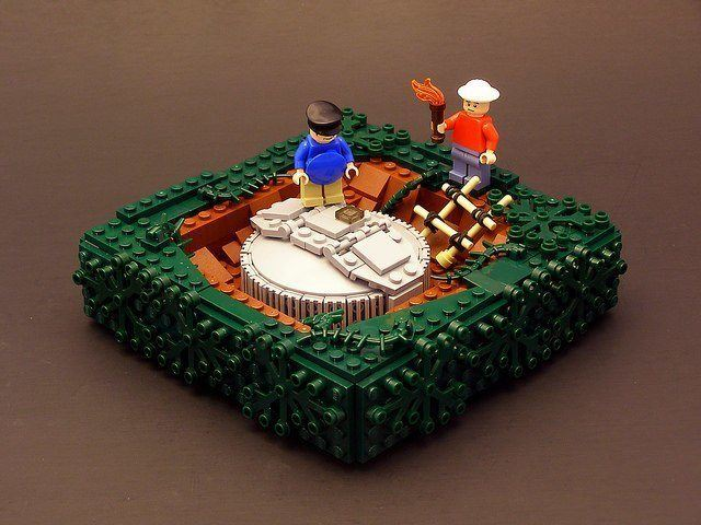Characters from the hit series Lost rediscover a buried portal in this lego sculpture by Legohaulic
