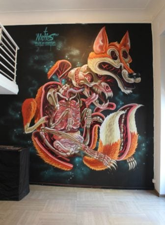 A red fox is torn to pieces and dissected in this macabre cartoon illustration that has become a wall mural
