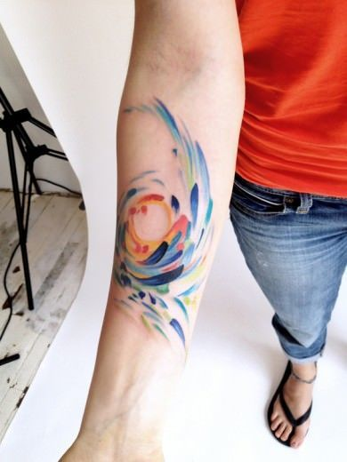 Amanda Wachob takes abstract art to skin in this floral or feathery tattoo design