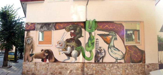 Graffiti art team 140 Ideas combine realism, illustration style and typography to create this mural of personified cartoonish animals
