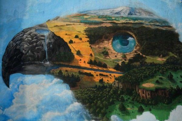 Graffiti art team 140 Ideas paint a raptor out of a birds eye view of a landscape