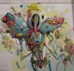 Parasites and other biological elements combine to create a strange character in this graffiti mural by Dhear One