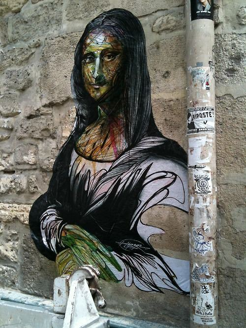 The Mona Lisa gets a makeover in this street art mural by French graffiti artist Hopare