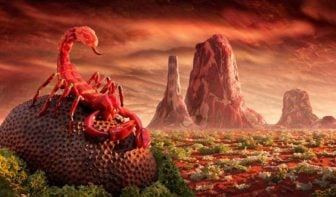 A red scorpion poses in the foreground of this foodscape, an artwork made out of food, by Chris Warner