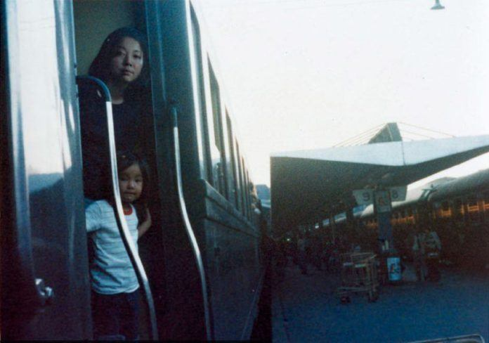Although these two people could be mother and child, it is actually Chino Otsuka posing with herself with the help of Photoshop