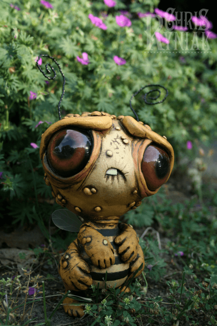 American artist Chris Ryniak creates amonster art doll of a bee born in a nuclear world