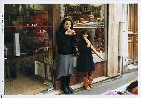 Chino Otsuka poses with her childhood self outside a shop in Paris, France