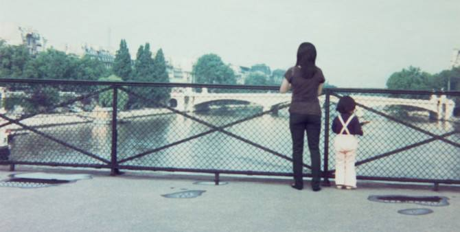 The adult and childhood versions of Chino Otsuka admire the view from a bridge in this Photoshopped picture