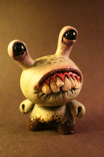 This cute little monster art doll by Chris Ryniak looks set on creating a bit of alien mischief