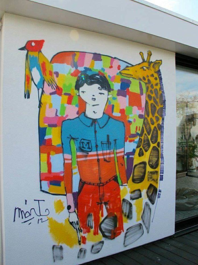 Mart Aire paints a boy dreaming of nature in this colorful graffiti mural