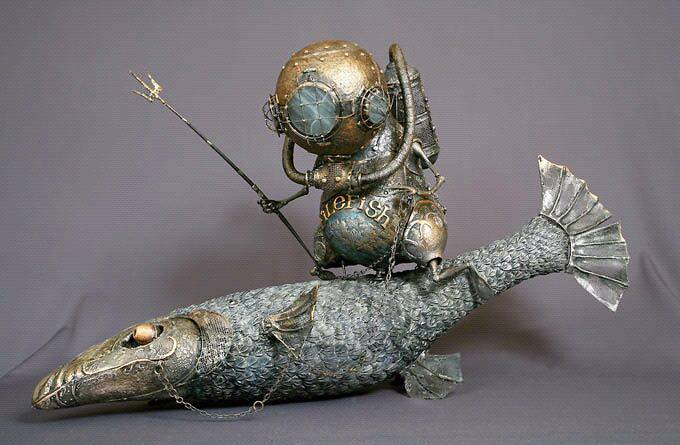 An alien diver with an antique diving helmet rides a fish as if it were a horse in this life like fantasy sculpture by Andrey Drozdov