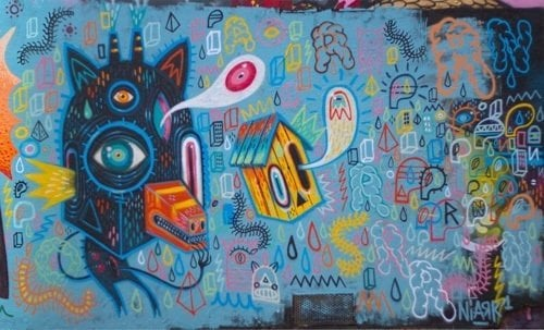 Colorful shapes and psychedelic patterns become monsters and beasties in this street art mural by Niark1