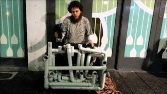 Pipe Guy Jake Clark shows off his home made PVC pipe instrument in Australia