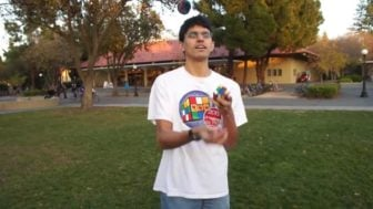 Guy solves a Rubix Cube while Juggling