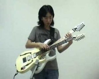 One Guy on Two Guitars Playing Super Mario Theme