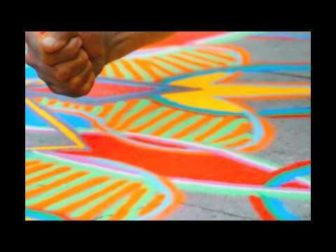 Watch How a Handful of Sand can Become a Huge, Beautiful Mandala