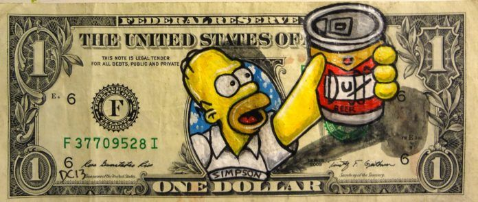 Artist Donovan Clark paints Homer Simpson, another American icon, on this dollar bill
