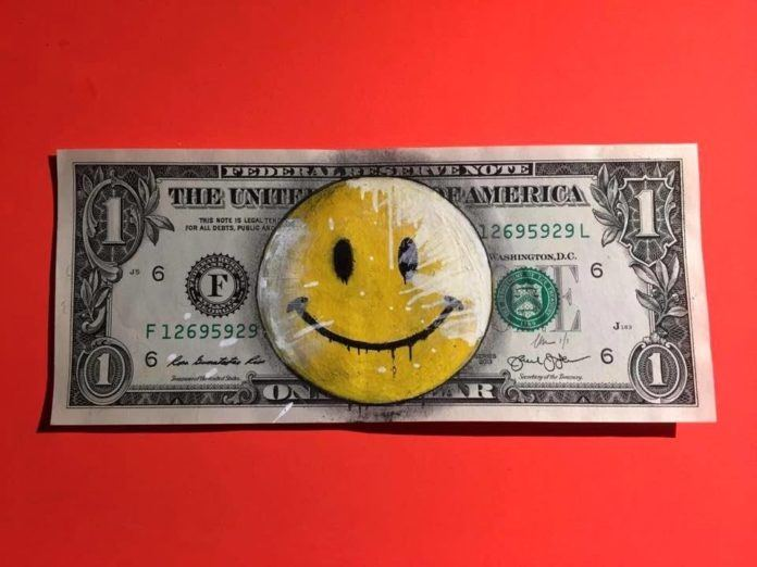 This one dollar bill doesn't have a portrait of a president, but of the emoticon the smiley face