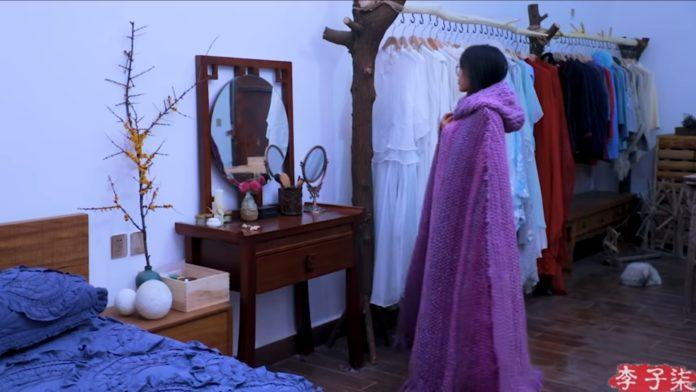 Liziqui tries on her hand crafted cloak for the first time, admiring its dramatic effect in her bedroom mirror