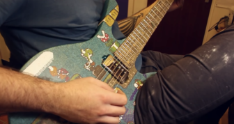 Cranmer plays his finished Super Marios guitar that took seven months and a whole lot of patience and skill to build
