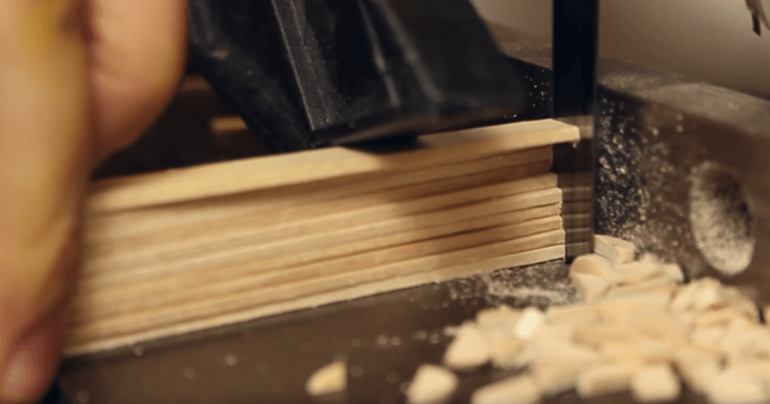 First, Cranmer cut his wooden popsicle sticks to size to prepare them for dyeing
