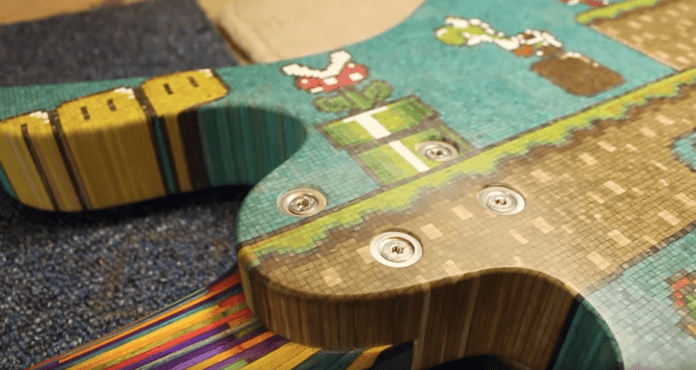 The white perspex pixels in the Mario fan art guitar stand out brilliantly against the dyed wood pieces, as seen on the green pipe and in the carnivorous plant